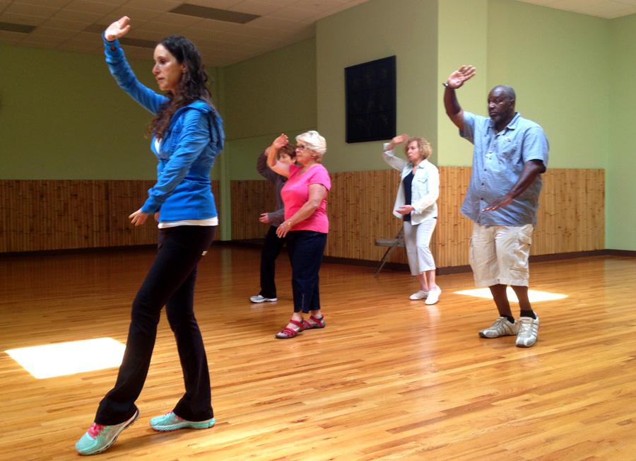 White crane spreads its wings. Tai Chi class with Barrie Austin